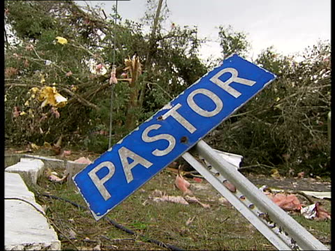 florida tornado aftermath family sat with a few salvaged possessions by collapsed building / sign saying pastor bent sideways / helicopter landing /... - pastor stock videos & royalty-free footage