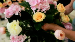 Florist at work, woman making fashion modern bouquet of different flowers