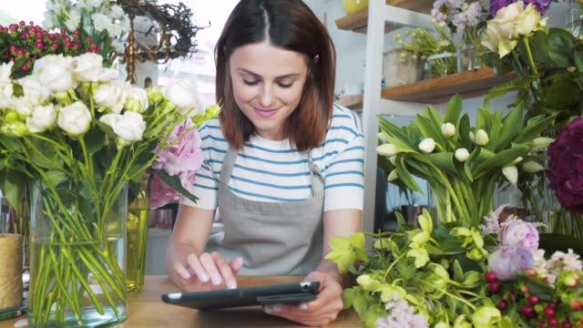 florist using a digital tablet. - e commerce stock videos & royalty-free footage