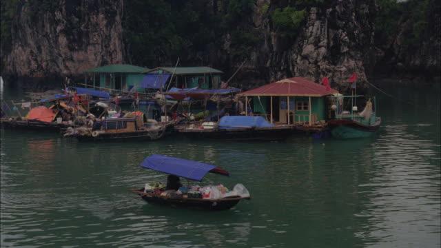 a flotilla of houseboats populate a river in vietnam. - flotilla stock videos & royalty-free footage