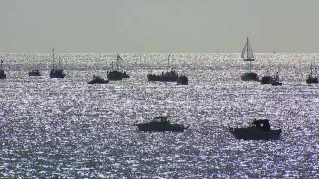stockvideo's en b-roll-footage met wwii flotilla of 'little ships' marks 75th anniversary of dunkirk rescue england kent ramsgate long shots of litle ships flotilla sailing out into... - ramsgate