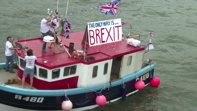 a flotilla of prozbrexit fishing boats sails up the river thames ahead of next weeks knife edge referendum over eu membership - flotilla stock videos & royalty-free footage