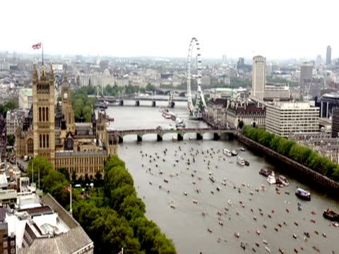 flotilla passes the london eye and houses of parliament during the thames pageant in celebration of the diamond jubilee - lambeth stock-videos und b-roll-filmmaterial