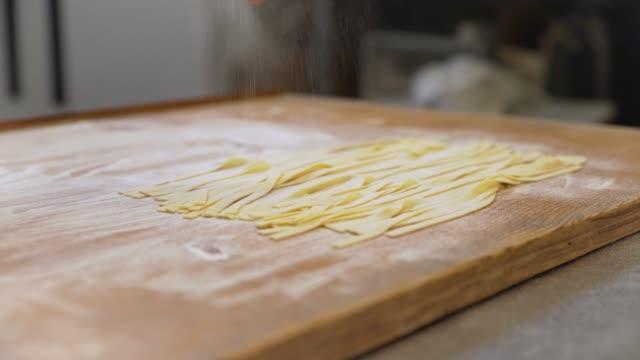flour sprinkled on tagliatelle pasta - preparation stock videos & royalty-free footage