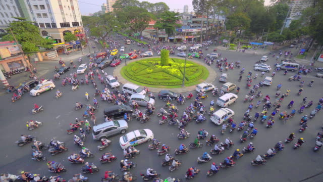 flow of motorbikes around roundabout, ho chi minh city, vietnam - vietnam stock videos & royalty-free footage