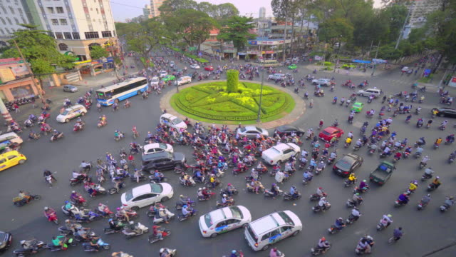 flow of traffic around roundabout in ho chi minh city, vietnam - roundabout stock videos and b-roll footage