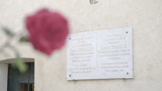 flower and commemorative plaque on louis braille house - braille stock videos & royalty-free footage