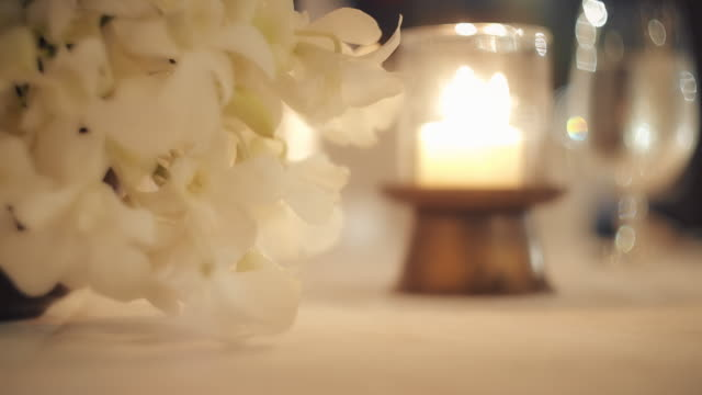 slo mo flower and lantern decoration on dinner - place setting stock videos & royalty-free footage