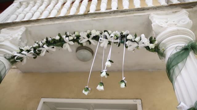 flower arrangement hanging in front of entrance doors - flower arrangement stock videos & royalty-free footage