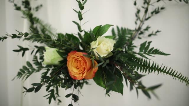 flower arrangement on wall close up - flower arrangement stock videos & royalty-free footage
