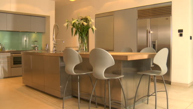 ws flower arrangement sitting stop table in empty, modern kitchen / london, england - home showcase interior stock videos & royalty-free footage