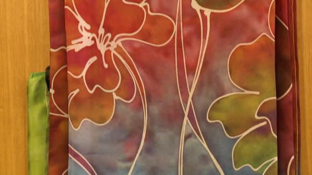 flower decorations on a batik fabric, kl, malaysia - batik stock videos and b-roll footage