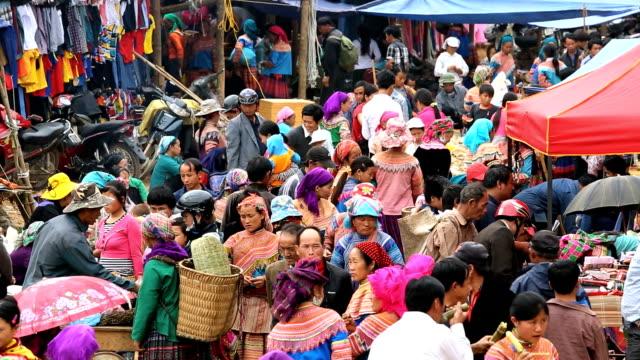 stockvideo's en b-roll-footage met flower hmong hill tribe people market nr bac ha north vietnam  - vietnam