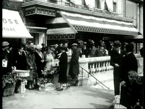 stockvideo's en b-roll-footage met flower sellers / paris, france - 1935