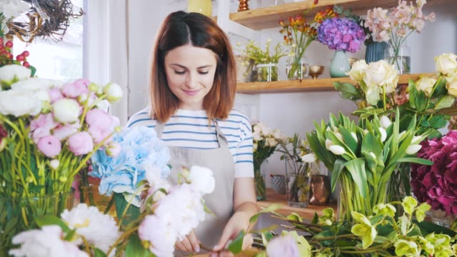 flower shop owner arranging bouquets. - composition stock videos & royalty-free footage