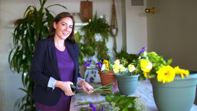flower shop owner. - flower arrangement stock videos & royalty-free footage