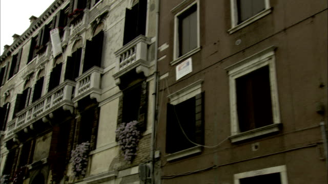 flowering plants spill over the balconies of ghetto apartments in venice. available in hd. - facade stock videos & royalty-free footage
