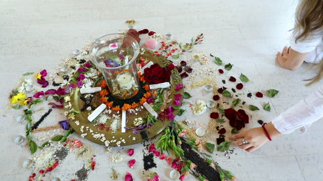 flowers and candles arranged on floor for new age ceremony - new age stock-videos und b-roll-filmmaterial