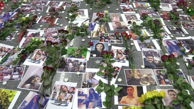 flowers and candles next to the portraits of passengers and the crew members of the ukrainian boeing 737-800 plane, that crashed in iran, are seen at... - ukraine stock videos & royalty-free footage