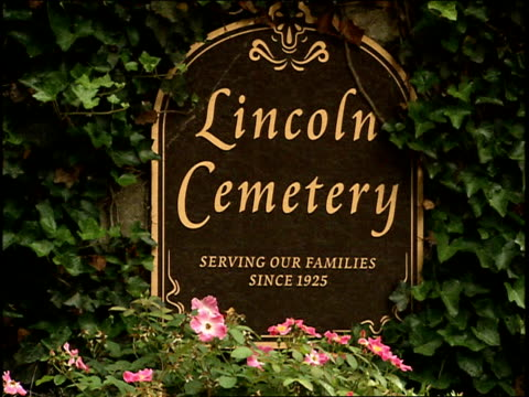 Flowers and Lincoln Cemetery Sign in Atlanta Georgia