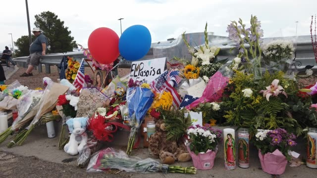 flowers and mementos are seen at a makeshift memorial outside walmart near the scene of a mass shooting which left at least 20 people dead on august... - memorial stock videos & royalty-free footage