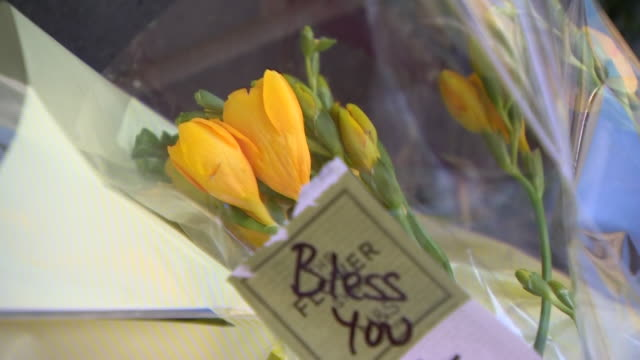 """flowers and messages of condolence for the victims of the reading stabbing terror attack - """"bbc news"""" stock videos & royalty-free footage"""