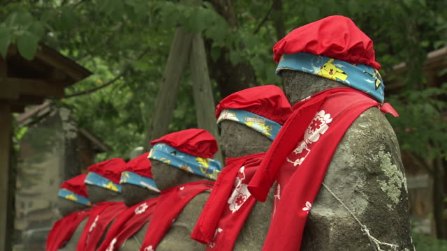 cu, flowers and six jizo statues, fukushima, japan - memorial event stock videos & royalty-free footage