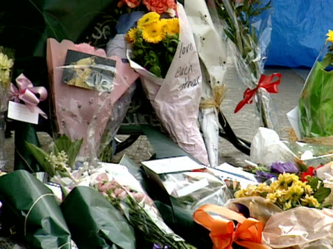 flowers are laid at the site of the bomb attack on the admiral duncan pub in soho april 1999 - ホモフォビア点の映像素材/bロール