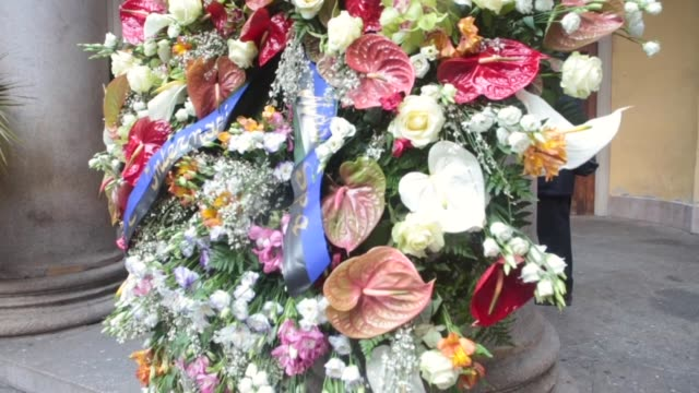 flowers are placed on the names inscribed during funeral of gian marco moratti, brother of angelo moratti and husband of letizia moratti, ex-major of... - トリビュート・イベント点の映像素材/bロール