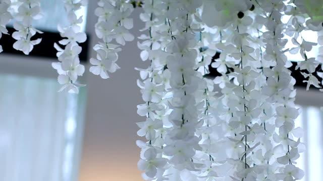 Flowers hanging on wedding hall