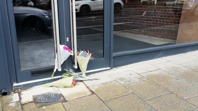 flowers have been laid outside the skillet in loughton. it's been reported mike thaslassitis was due to open the restaurant with a business partner.... - mike love stock videos & royalty-free footage