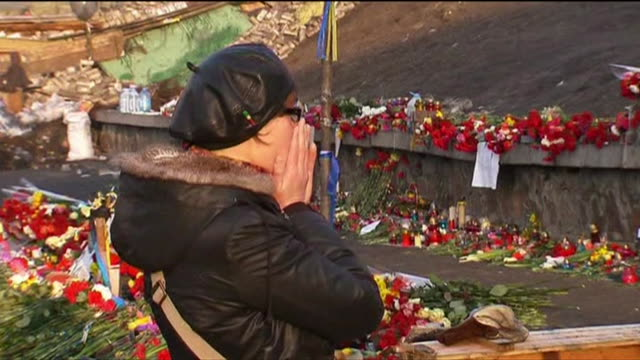Flowers laid and mourners paying their respects for killed protesters in Kiev's Independence Square after days of antigovernment clashes with police