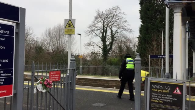 flowers left at horsley station near guildford surrey after a train passenger was stabbed to death in front of his 14yearold son police hunting a... - サリー州点の映像素材/bロール
