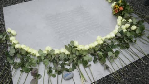 flowers lie on a memorial plaque at the buchenwald concentration camp memorial to commemorate victims of the holocaust on january 26, 2018 near... - weimar stock videos & royalty-free footage