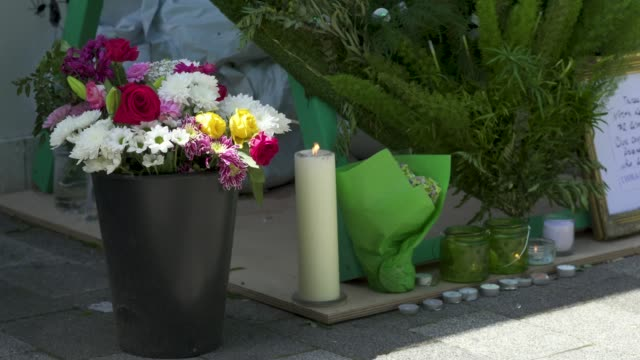 flowers next to a wall where messages of support have been written surrounding grenfell tower in west london on june 14 on the third anniversary of... - domestic kitchen stock videos & royalty-free footage