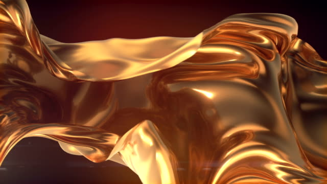 vídeos de stock e filmes b-roll de flowing gold cloth abstract background animation. 3d rendering. 4k uhd - abstrato