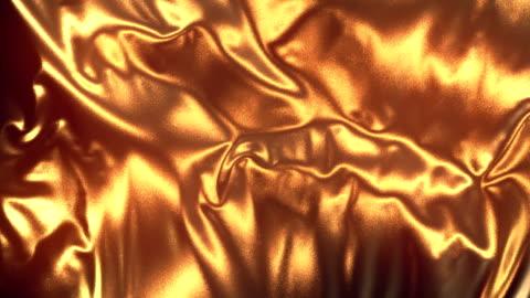 flödar guldet trasa abstrakt bakgrund animation. 3d-rendering. 4k uhd - guldgul bildbanksvideor och videomaterial från bakom kulisserna