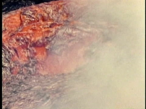 1970 MS Flowing hot lava in red-hot volcanic river / Kilauea, Hawaii / AUDIO