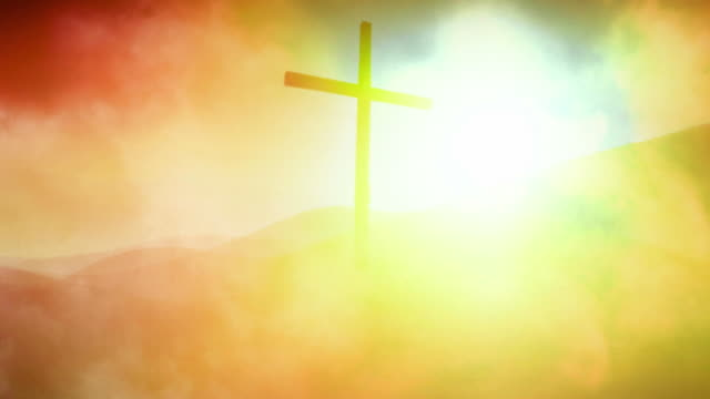 the cross. flowing landscape - clouds against sun. (loop) - religious cross stock videos & royalty-free footage