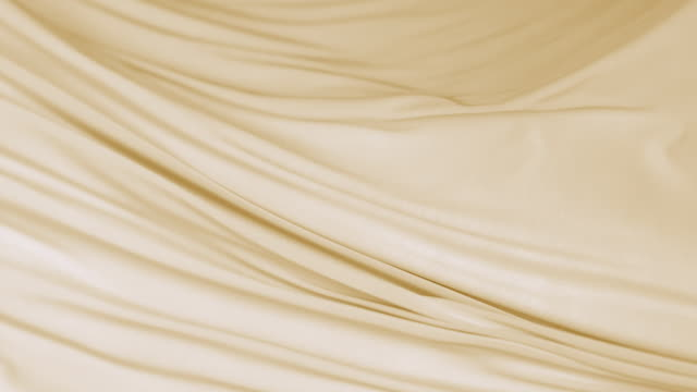 vidéos et rushes de flowing silky gold jersey fabric background, closeup - beige