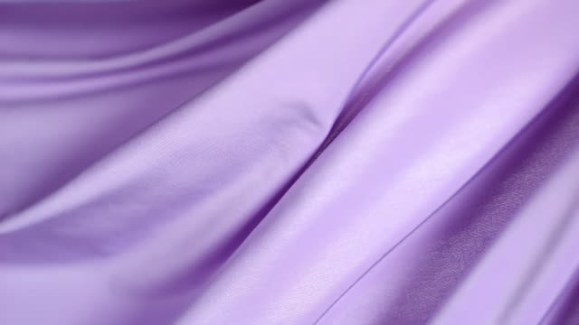flowing silky purple jersey fabric background, closeup - satin stock-videos und b-roll-filmmaterial