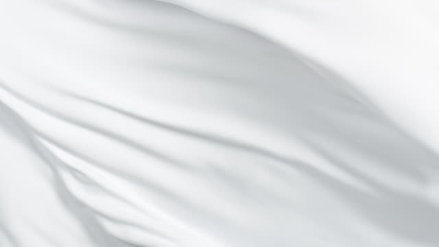 Flowing silky white jersey fabric background, closeup