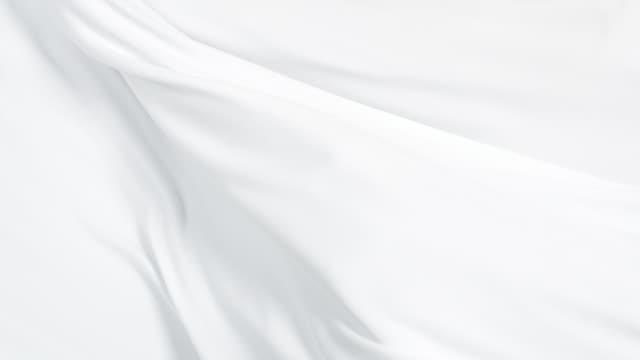 vidéos et rushes de flowing silky white jersey fabric background, closeup - curtain