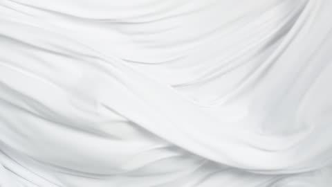flowing silky white jersey fabric background, closeup - 絹点の映像素材/bロール