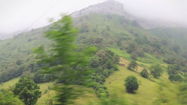 flowing through a valley between mountains - parque natural stock videos and b-roll footage