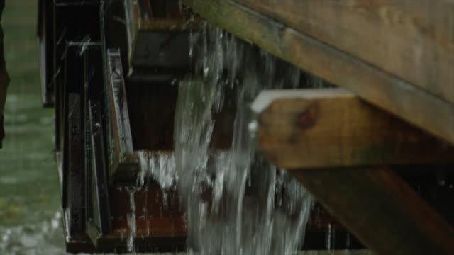 flowing water and waterwheel - water wheel stock videos & royalty-free footage