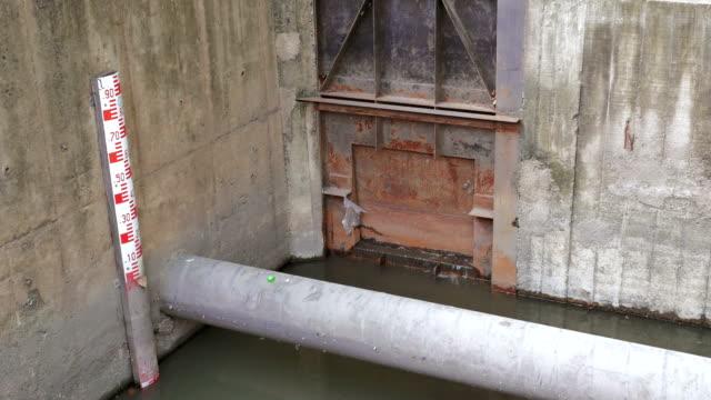 Flowing water at floodgate,Tilt Up