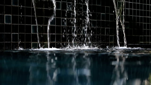 flowing water into swimming pool