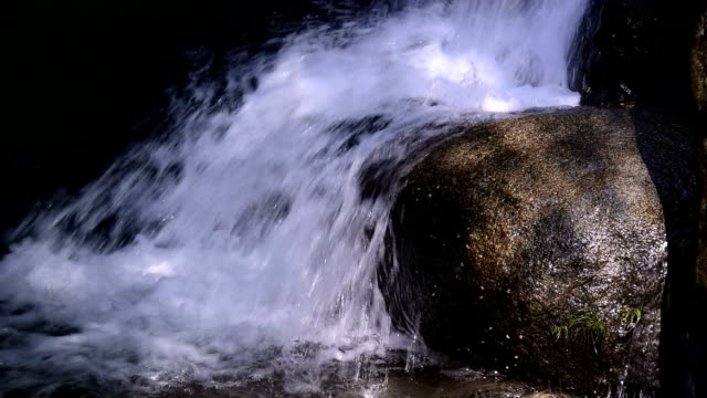 flowing water running over rocks - running water stock videos & royalty-free footage
