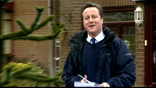 leftover swine flu vaccine to be used as death toll reaches 50; lancashire: oldham: ext david cameron posting conservative campaign leaflet through... - letterbox stock-videos und b-roll-filmmaterial